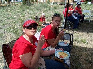 Deanna Underwood and Melissa Huck take a break for lunch at Women's Build